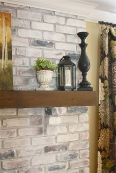 White washing ugly dated brick. I love it!!  The Yellow Cape Cod: White Washed Brick Fireplace~Tutorial