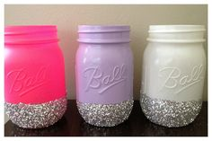 Bright & Glittery Decorative Mason Jars. Painted and glitter dipped mason jars that can be used as a make-up brush holder.