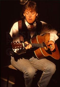 Paul on acoustic guitar