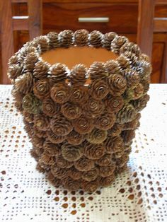 Pine cone covered plant pot