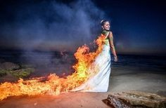 Newlywed Natasha Samuel captured the crazy moment her pristine white wedding dress is lit on fire before she bolts towards the ocean in a hurried attempt to put the flames out. Trash The Dress photo shoots, where brides purposely ruin their wedding gowns in the name of art, is a decade-long trend that can involve anything from colorful paint bombs, to buckets of mud and in some case, balls of fire. Photo credit: White Studio Photography