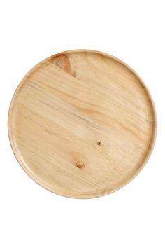 Plateau en bois: Plateau rond en bois. Diamètre 32,5 cm, hauteur 1,5 cm.