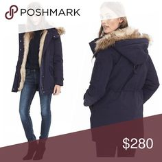 Lux Navy Faux Fur Parka This coat is the perfect combination of stylish and warm. The entire hood is lined with faux fur - not just the edge. Note that only the edges of the body by the zipper are fur-lined. Build in waist and bottom clincher.   Single welt chest pockets. Snap closure flap hip pockets. Zipper sleeve pocket. Down filled. Water resistant. Banana Republic Jackets & Coats Puffers