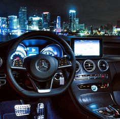 Mercedes Benz C-class 2015 at a night view of Downtown Miami