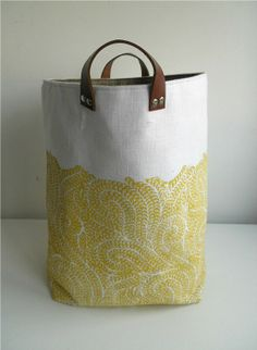 Medium storage bin hand printed ochre on white linen with leather handles in Burrows