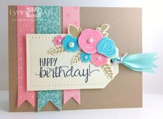 handmade birthday card from The Queen's Scene .... Color Throwdown 248 ...  pretty colors ...  sweet tag with stamped and punched flowers grouped in one corner ... fishtail banners in the background ... wonderful card!