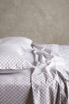 Add a little pattern to your bed. I love the surprise of patterned sheets when I get into bed.