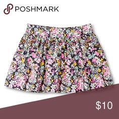 Floral Skirt Floral skirt is fully lined and made from 100% cotton. Features two front slash pockets. Floral design is gray, pink, blue, yellow and white. Coming from a smoke-free, pet-free home. Genuine Kids Dresses