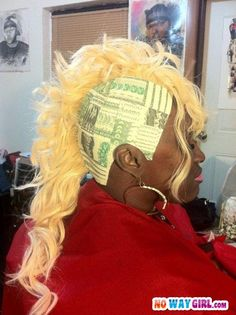 That hairstyle is money....and a hot mess.
