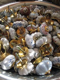 Door knobs amazing! This would be a great idea, but I think I would like to find crystal handles of different colors.