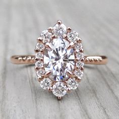 Oval Forever One™ Moissanite Engagement Ring with Diamond Halo (1.25ct)
