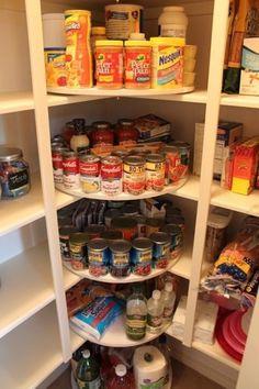 Organizing pantry.  Good use of the corner.  Lazy Susan?