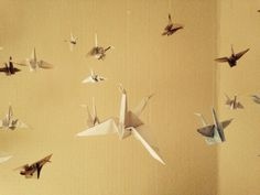 Origami crane wall art, recycled maps and papers