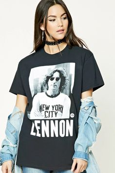 "A cotton tee featuring a graphic of John Lennon in a New York City tee, an ""Imagine Peace"" and face graphic on the front, a round neckline, and short sleeves."