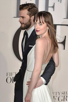 Fifty Shades Of Grey please notice hoe respectful her puts his hands above her waist and not on her invisible backside .You have to love him for all he endured