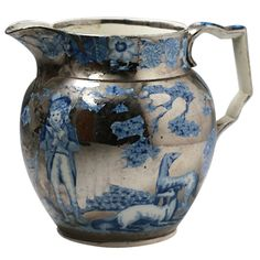 English pottery silver luster pitcher with blue and white transfer. The underglaze blue and white transfer depicts a rural sporting scene in the Moreland style. – England, circa 1820 - John Howard, Woodstock, UK