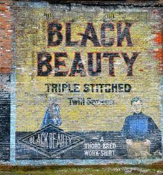 Black Beauty shirts ghost sign, Detroit, Michigan