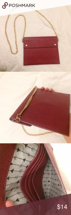 """Maroon and gold chain crossbody/clutch purse Super cute cross body purse that can also double as a clutch by removing the chain. This purse has been worn two or three times and is in excellent condition. The dimensions of the bag are 6.5 x 8"""". It's a small and very flat bag with several card slots. Ideal for fitting your cell phone, car keys and credit cards. Francesca's Collections Bags Crossbody Bags"""
