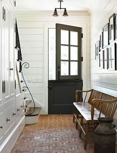 Love the Dutch door!This mudroom with it's brick flooring reminds me of old English stables with their brick flooring and dutch doors. It's ultra cool and a subtle transition from the barn into the heart of the home. Deco Design, Design Case, Design Room, House Ideas, Character Home, Brick Flooring, Brick Pavers, Wood Paneling, Shiplap Siding
