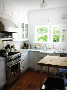white kitchen, lyon stools, boos butcher block, blue star range, jielde