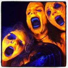 Jeff Hardy in face paint with his family and the Omega Heavyweight Title.