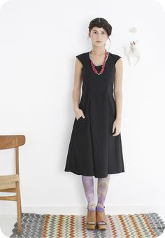 The Elsa Dress from Specks & Keepings (like the black dress & red necklace, not so much the bottom half)