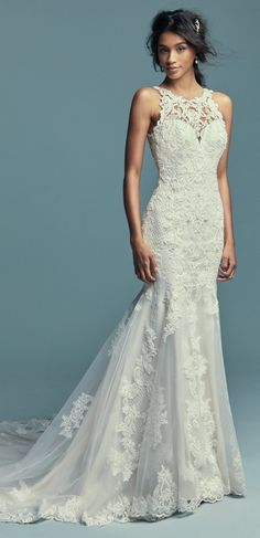Maggie Sottero - KENDALL, Classic yet striking, this fit-and-flare wedding dress features beaded lace motifs, crosshatch details, and Swarovski crystals over tulle. Lace motifs adorn the illusion halter over sweetheart neckline and illusion back.