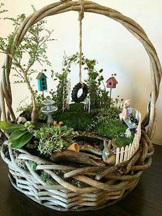 I've never seen a fairy garden in a basket before. Very creative.
