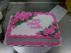 A whipped cream quarter sheet cake with piped roses.