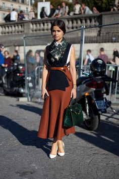 STREET STYLE SPRING 2013: PARIS FASHION WEEK - Miroslava Duma pairs layers and a midi skirt in rich fall tones.