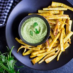 These curried parsnip fries are baked (not fried!) until crispy and served with a creamy cilantro hummus dipping sauce. Recipes Appetizers And Snacks, Vegan Appetizers, Healthy Snacks, Snack Recipes, Drink Recipes, Healthy Eats, Side Recipes, Veggie Recipes, Vegetarian Recipes