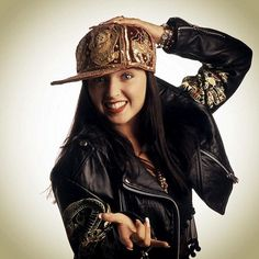 Vintage: In true 90s fashion, Dannii is wearing a red flat brim hat doused in gold sequins to form an oriental print