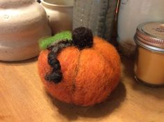 A personal favorite from my Etsy shop https://www.etsy.com/listing/246273172/small-needle-felted-pumpkin
