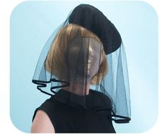 black hat with veil black mourning 1960s - like the one Jackie Kennedy wore.