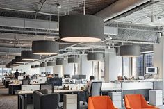 Silenzio lamps provide quality of light combined with high levels of acoustic comfort in the new open plan offices of Bullhorn in Boston. The outer fabric of the suspensions has been chosen to match the color mix of the furnishings High End Lighting, Suspended Lighting, Office Lighting, Commercial Lighting, Commercial Design, Open Ceiling, Ceiling Lights, Lighting System, Lighting Design