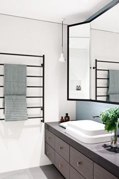 bathroom towel rail grey cabinetry