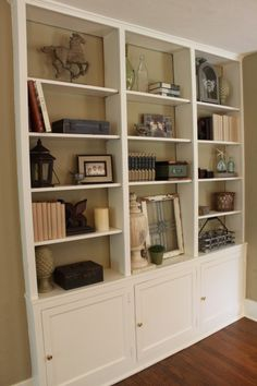 love. I would paint the back wall of shelving though for a contrast color pop.