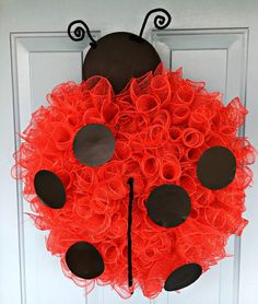 Ladybug Wreath I began with a 12 inch wreath form and used red pipe cleaners to build a support across the center of my wreath form. This is easy to do as shown above. I used 6 inch red deco mesh. I cut it into 8 inch pieces and rolled…
