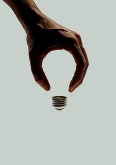 Fay - The gesture shapes the circle arc of the main part of light bulb, which is a really interesting and creative idea! The visual metaphor in this example maybe the symbol of human wisdom or creation.
