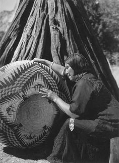Paiute Lucy Telles, also known as Pa-ma-has, seated beside her largest basket, completed in 1933 after about four years of work, at famous Mono Lake, Yosemite.