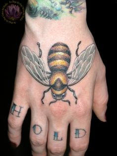 tattoo by James Kern... Bee tattoo inspiration... not on my hand though