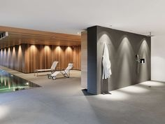 Indoor pool and shower area in a home in Fribourg, Switzerland designed by Ralph Germann Architectes
