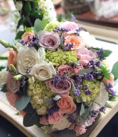 Beautiful bridal bouquet designed with green hydrangeas , white roses , soft pink roses , spray roses , Caspia  and eucalyptus