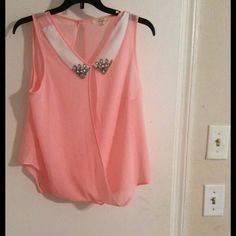 Fashion top Light pink top with white collar has jewels at the top. Open in front and back. Good condition Tops Blouses