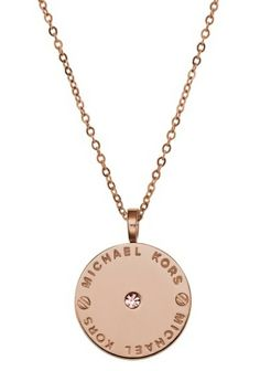 Capture the glamour and elegance of New York with this chic pendant necklace from the Michael Kors Logo collection. Featuring a rose gold-plated disc pendant and chain set in the centre with a dazzling white crystal and the Michael Kors logo. - 0793231 - £89