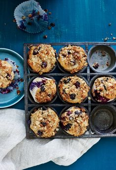 Blueberry-Sour Cream Muffins | When our crumbly-crisp topping meets the light, fluffy belly of this muffin, you'll swoon.