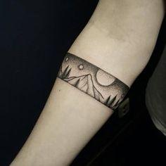 Landscape armband tattoo by Ben Doukakis