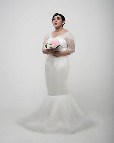 This is a pretty fit-and-flare plus size wedding dress that brides can have our firm customize hjowever they like.  We are in the USA and specialize in affordable #plussizeweddingdresses for curvy brides that can be made to their personality and style. We can also make very close #replicaweddingdresses that look like the original but cost much less.  Email us from our website for pricing and more details on plus size wedding dresses at www.dariuscordell.com/