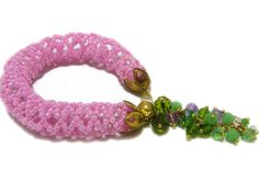 Pink bracelet - Bead crochet bracelet -Seed beads bracelet - Beaded rope - Seed beads jewelry - Beadwork - Summer bracelet - Gift for her This bead crochet rope bracelet is made from pink seed beads and decorated with crystal beads. It will be perfect to create a unique look for yourself both for special occasion and every day. The bracelet don´t take amiss if getting wet someday, but please don´t wear during swimming or bathing. ◆MEASUREMENTS Length 7.48in ( 19cm ) Perfect fits approx to…