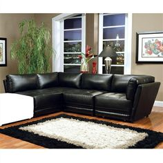 This sleek contemporary sectional sofa will be a stylish addition to your living room. The plush overstuffed cushions will keep you cozy, with a high polyester fiber filled back and deep modern tufted look seat cushions. This modular sectional features two armless chair components, and two plush corner units and can be configured to meet your needs.